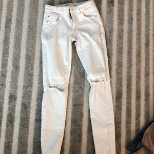 White jeans with knee cut outs